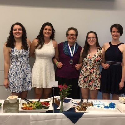 Photo of Letty Naigles with graduates